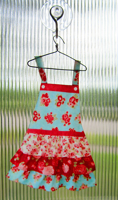 Tiny apron on hanger
